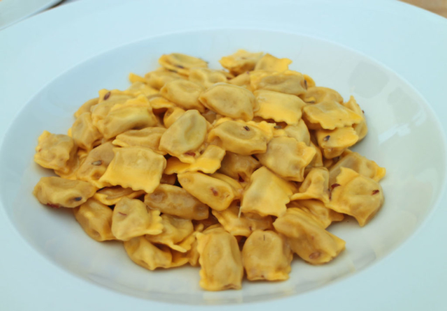 "Traditional ravioli ""plin"" with butter and lavender sauce"