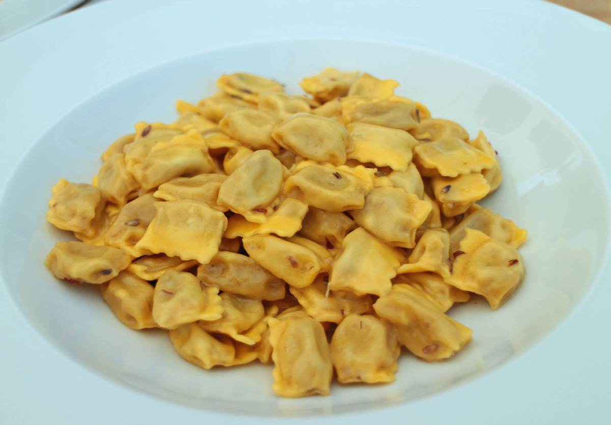 """Traditional ravioli """"plin"""" with butter and lavender sauce"""